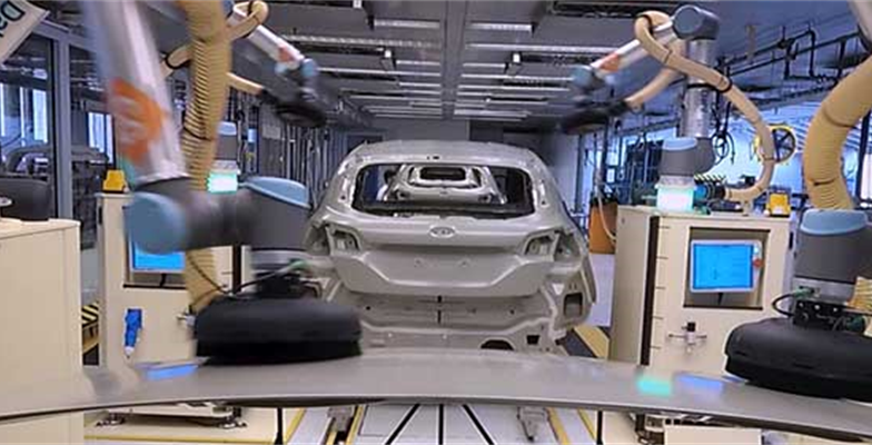 Robots work alongside Ford engineers